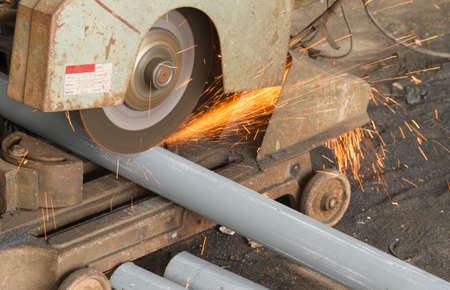 Cutting steel by cutting fiber in steel factory. Stock Photo