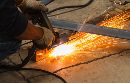 Manual Plasma Cutting Machine in Manufacturing Industry - Conditions Hazardous Working. Stock Photo