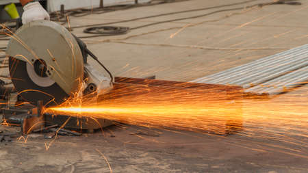 Sparks fire from while cutting steel.