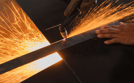 Unsafe work - Using plasma cutting machine without safety protection.