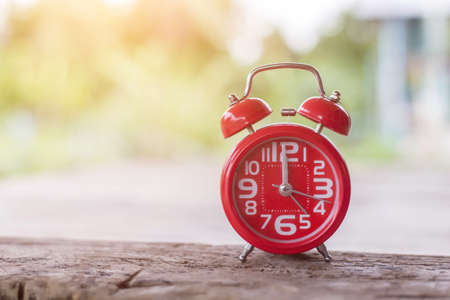 Alarm clock on wooden background Stock Photo