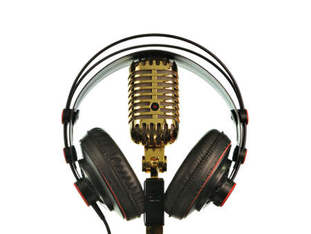Retro golden microphone with headphone photo