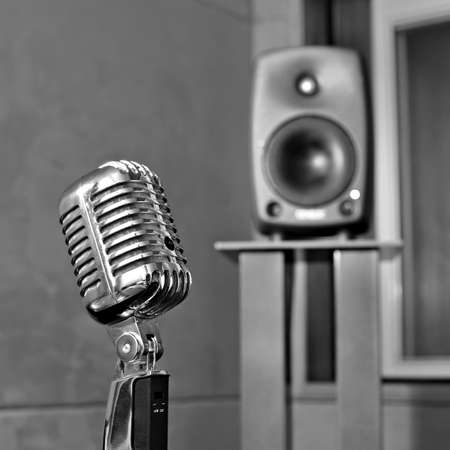 Retro microphone in a listening room to the monochrome image photo