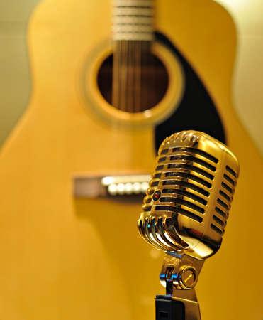 air guitar: Retro golden microphone, guitar background Stock Photo