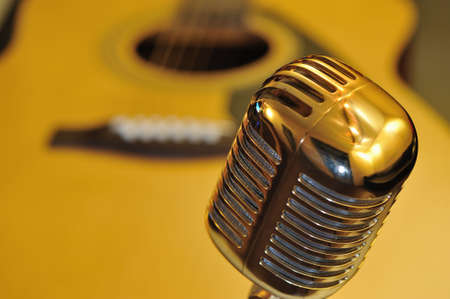 elvis: Retro golden microphone, guitar background Stock Photo
