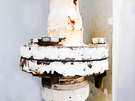 joint of two flanges by bolts and nuts, Bolts base Blurred soft focus,  Fastening base column, Old rusty steel nut