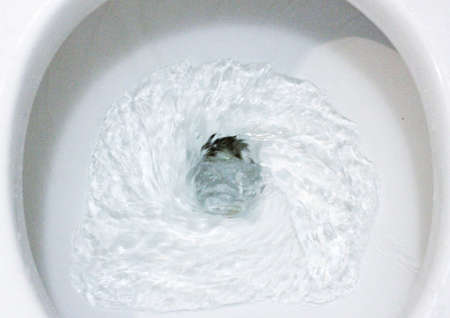 selective focus close up flushing toilet bowl for sanitary, Toilet, Flushing Water, close up, water flushing in toilet, A photo of a white ceramic toilet bowl in the process of washing it off. Ceramic sanitary ware for correcting the need with an automatic flushing device