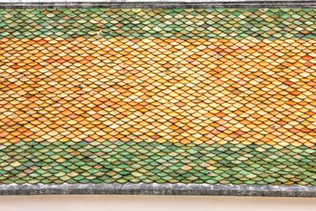 pattern for background, roof, Pattern of Temple roof tile in thai style, Ancient Thai roof, Yellow and green tile pattern