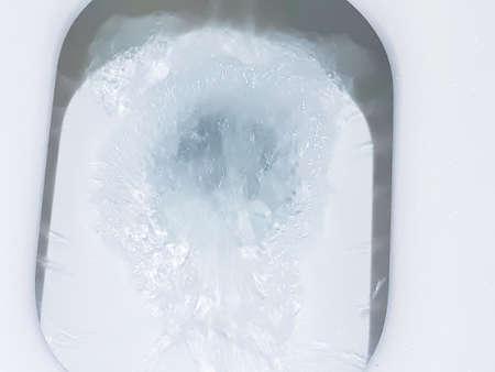 Toilet, Flushing Water, flush toilet, Closeup look at toilet, white toilet, White toilet in the bathroom, Top view of toilet bowl
