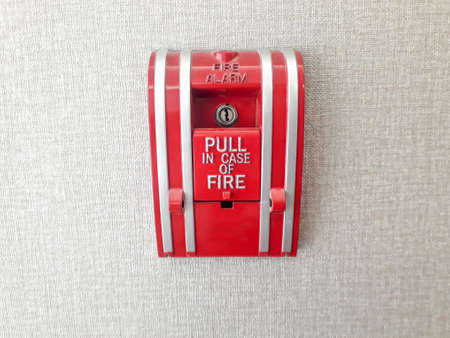 Fire alarm, Active fire protection, Fire Call Point Button, Fire alarm. Fire alarm panel on white wall, Red fire alarm isolated on background