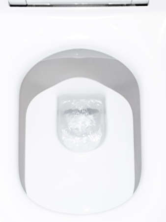 Toilet, Flushing Water, flush toilet, Closeup look at toilet, white toilet, White toilet in the bathroom, Top view of toilet bowl