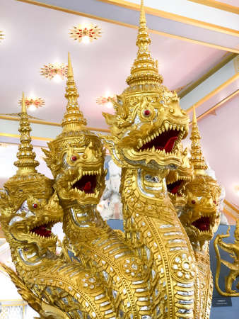 Naga statue in the temple, The Golden Naga statue in Thai temple.Serpent animal in Buddhist legend., Naga statue or King of nagas in the temple. Editöryel