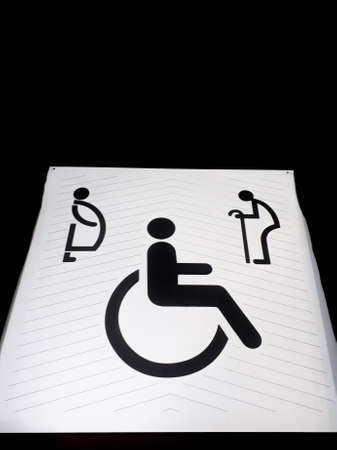 Disabled sign on grunge cement floor, wheelchair walkway symbol, wheelchair slope, friendly design architecture for all people, Symbol walkway for people with disabilities, white disabled sign on working street Stok Fotoğraf