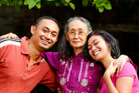 family portrait of asian ethnic senior mother with young adult son and daughter
