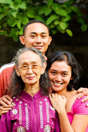 asian ethnic senior woman with young adult son and daughter photo