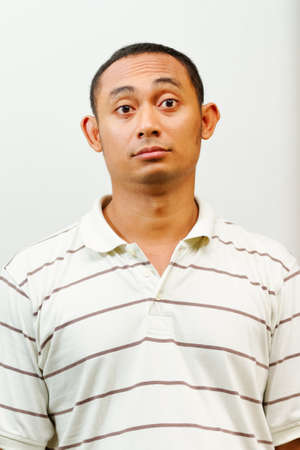 ethnic asian young male with confused face expression photo