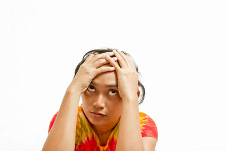 stressful: stressful asian young woman put hands on head