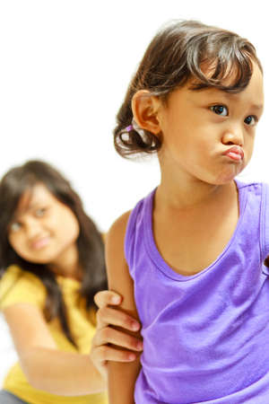 asian ethnic teenage sister counsel moody kid Stock Photo