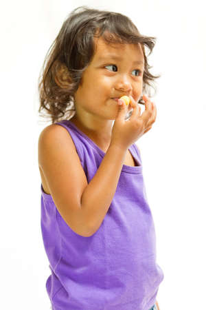 asian ethnic child consume snack isolated Stock Photo - 12931708