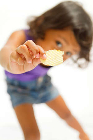 consume: asian ethnic child consume potato chip snack isolated
