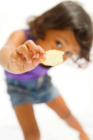 asian ethnic child consume potato chip snack isolated Stock Photo - 12931705