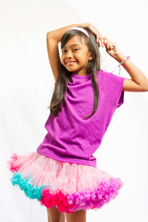 portrait of asian ethnic child happy with tutu skirt photo