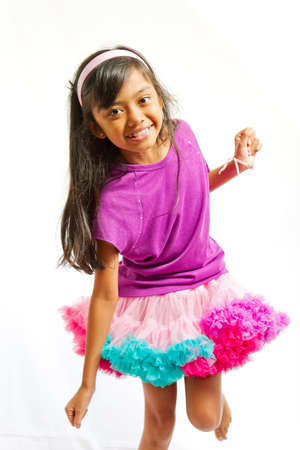 asian ethnic little girl happy dancing with tutu skirt Stock Photo