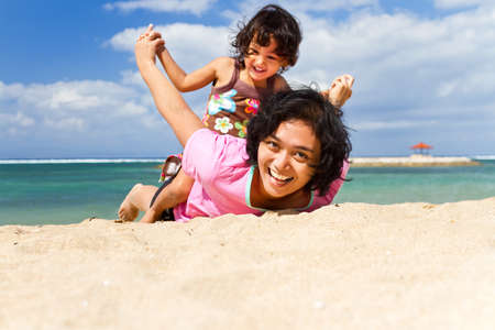 Asian ethnic mother and child happy playing together on the beach Stock Photo - 12931738
