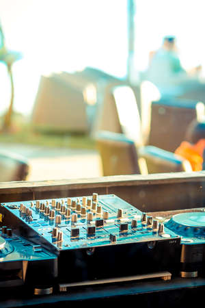 party system: sound system audio mixer controller at outdoor cafe