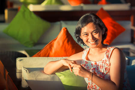 feeling happy: Portrait of Asian Ethnic Adult Woman Feeling Happy and Smiling Stock Photo