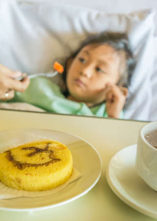 fond: Sick Asian Ethnic Little Girl Hospital Patient not Fond of Food