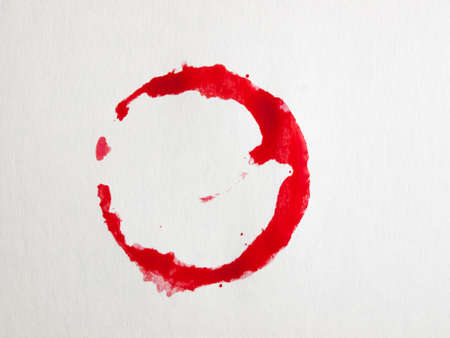 red wine stain: Red wine stain on the napkin