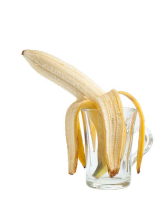 limp: Peeled sadly banana bend in a glass cup Stock Photo