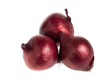 Three red onion bulbs isolated on white background