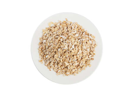Plate with muesli isolated on white background