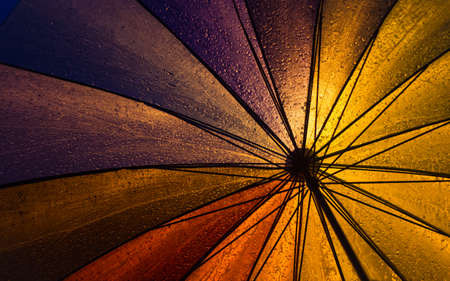 Colorful Umbrella Under Heavy Rains