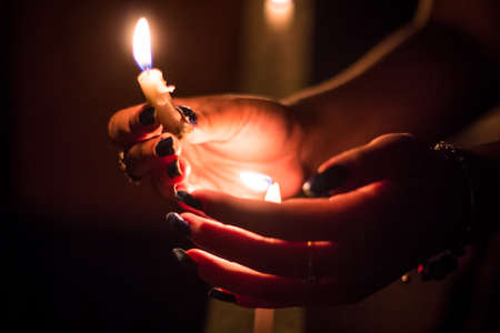 Lighting Candles at a Night Memorial