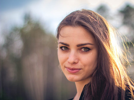 close portait of A beautiful brunette girl posing in a field on autumn. Eyes. Art photo. Stock Photo