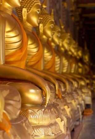 faith light gold color hand thai art Buddha statue photo