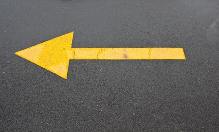 wet yellow arrow road or concept and slippery photo