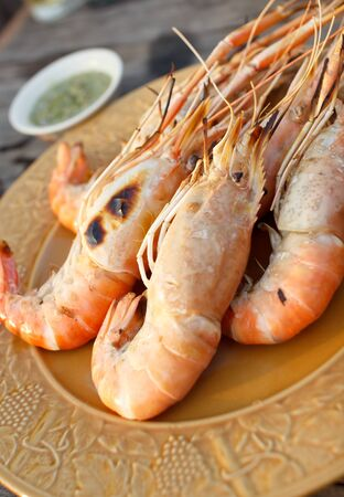 grilled prawns and seafood sauces photo