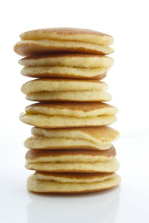 A stack of plain pancakes on a white background photo