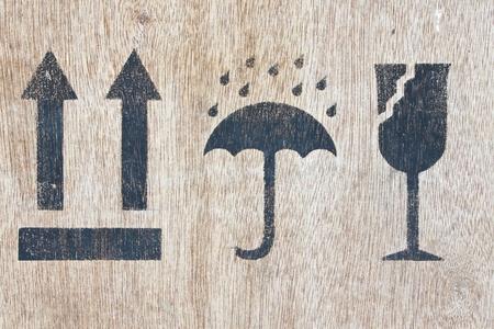 image close-up fragile symbol on wood photo