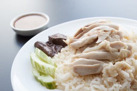 chicken rice: Hainanese chicken rice and sauces,khao mun kai Stock Photo