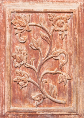 Pattern of flower carved on wood photo