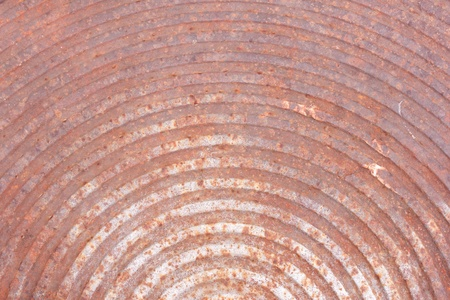 Rusted manhole cover,curve line pattern Metal Texture photo