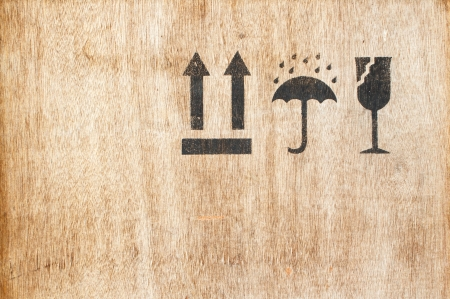 Safety fragile icon on old wood board with space Stock Photo - 20861372