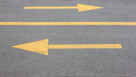 Yellow arrow right and left on asphalt street for the concept of choice photo