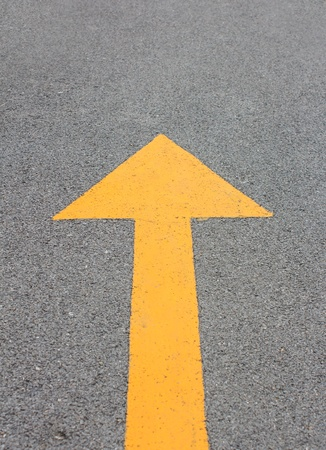 Yellow arrow up on asphalt street for the concept of choice Stock Photo - 21526269