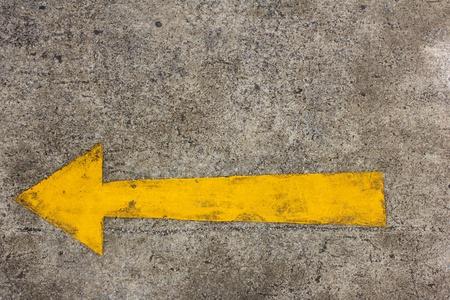 Yellow arrow left on asphalt street for the concept of choice photo